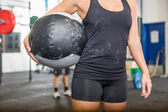 Athlete Carrying Medicine Ball At Gym — Stock Photo