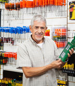 Customer Holding Packed Product In Hardware Shop — Stock Photo
