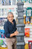 Confident Senior Man Stacking Toolboxes In Store — Stock Photo