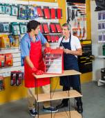 Salesmen With Drill Toolbox In Hardware Store — Stock Photo