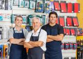 Salesmen Standing Arms Crossed In Hardware Shop — Stock Photo