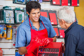 Salesman Showing Drill Bit To Man In Store — Stock Photo