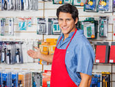 Young Vendor Welcoming At Hardware Shop — Stock Photo