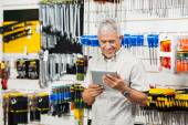 Customer Holding Digital Tablet In Hardware Shop — Stock Photo