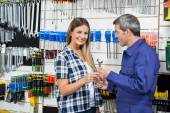 Female Customer Receiving Wrench From Customer — Stock Photo