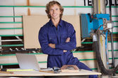 Confident Carpenter With Arms Crossed In Workshop — Stock Photo