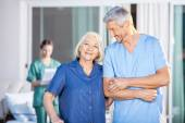Happy Senior Woman Standing With Male Caretaker — Stock Photo