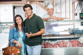 Couple Smiling In Butchery — Stock Photo