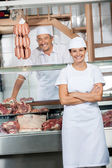 Butchers At Display Cabinet In Butchery — Stock Photo