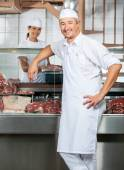 Confident Butchers With Female Colleague In Butchery — Stock Photo