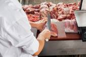 Cropped Image Of Male Butcher Cutting Meat — Stock Photo