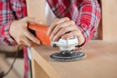 Carpenters Hands Using Sander On Wooden Shelf — Stock Photo