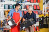 Man Looking At Salesman While Selecting Toolbox — Stock Photo