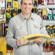 Man Buying Handsaw In Hardware Store — Stock Photo #58502691