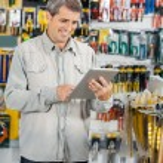 Customer Using Digital Tablet In Hardware Store — Stock Photo #58505629