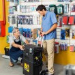 Salesman Showing Tool Case To Customer In Store — Stock Photo #58505915