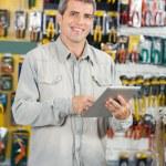 Man Using Digital Tablet In Hardware Store — Stock Photo #58506135