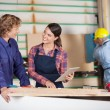 Carpenters With Digital Tablet Discussing In Workshop — Stock Photo #58506157