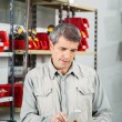 Man Scanning Product In Hardware Store — Stock Photo #58506181