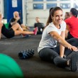 Woman Doing Stretching Exercise At Cross Training Box — Stock Photo #58507271