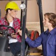 Supervisor In Forklift Shaking Hands With Carpenter — Stock Photo #58508209