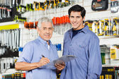 Father And Son Preparing Checklist In Hardware Store — Stock Photo