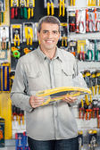 Man Buying Handsaw In Hardware Store — Stock Photo