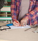 Midsection Of Worker Drawing Blueprint — Stock Photo