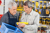 Salesman Assisting Customer In Buying Product — Stock Photo