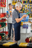 Senior Worker Holding Tool Basket In Store — Stock Photo