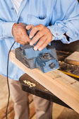 Senior Carpenter Shaving Wood With Electric Planer — Stock Photo
