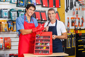 Salesmen Showing Drill Bits In Shop — Stock Photo
