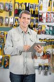 Man Using Digital Tablet In Hardware Store — Stock Photo
