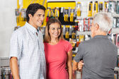 Couple Conversing With Man In Hardware Store — Stock Photo