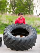 Athlete Flipping Truck Tire Outdoors — Stock Photo