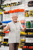 Customer Gesturing Thumbs Up In Hardware Shop — Stock Photo