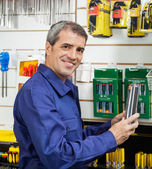 Worker Holding Packed Product In Hardware Store — Stock Photo