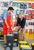 Man Choosing Tool Cases While Salesman Assisting Him — Stockfoto