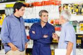 Worker Communicating With Customers In Hardware Shop — Stock Photo