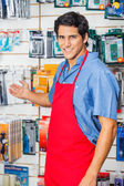 Young Salesman Welcoming At Hardware Shop — Stock Photo