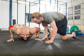 Trainer Motivating Man In Doing Pushups — Stock Photo