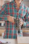 Midsection Of Male Carpenter Drilling Wood — Stock Photo