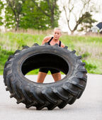 Fit Woman Flipping Tire Outdoors — Stock Photo
