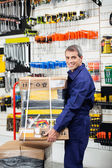 Worker Keeping Tool Package On Trolley — Stock Photo