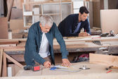 Senior Carpenter Drawing Diagram On Blueprint — Stock Photo
