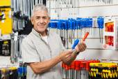 Happy Customer Comparing Screwdrivers In Hardware Shop — Stock Photo