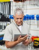 Senior Man Using Digital Tablet In Hardware Shop — Stock Photo