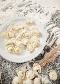 Raw Ravioli Pasta With Rolling Pin On Messy Counter — Stok fotoğraf