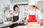 Chefs Conversing While Preparing Pasta In Kitchen — Stock Photo
