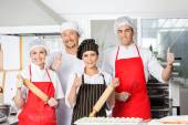 Confident Chef Team Gesturing Thumbsup In Kitchen — Stock Photo